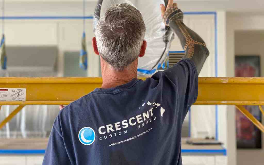 Crescent Homes Maui employee remodeling a home.