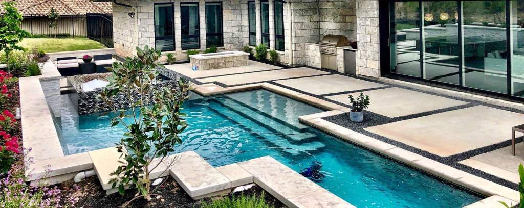 Pool built into family-friendly deck with Jacuzzi and barbecue