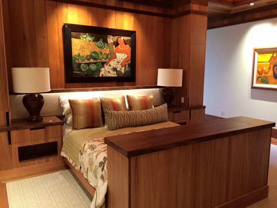 Master bedroom with wooden wall and footboard recently refinished.