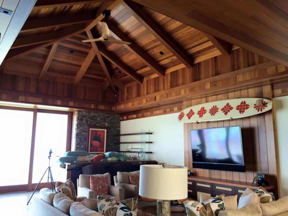 Living room with exposed rafters freshly refinished by Crescent Homes Maui