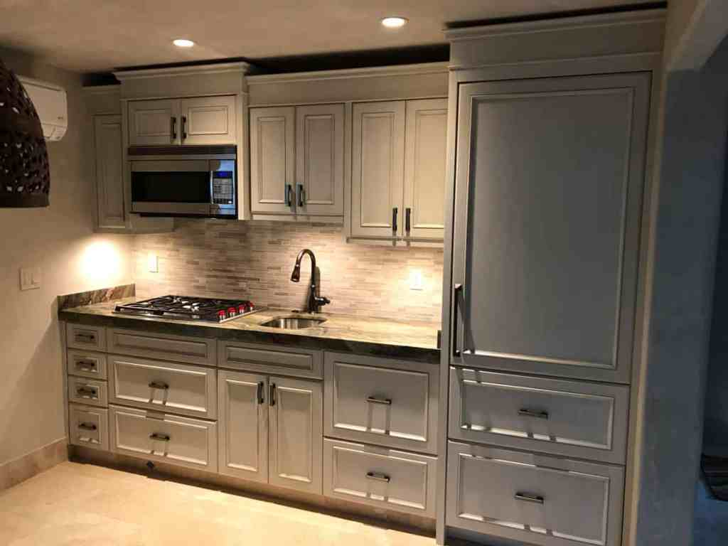Recently remodeled kitchen with freshly restored and repainted cabinet doors