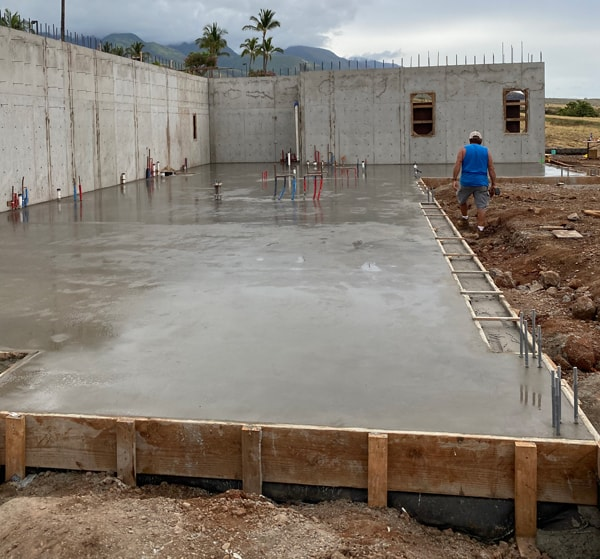 Image of recently poured concrete foundation that is now curing