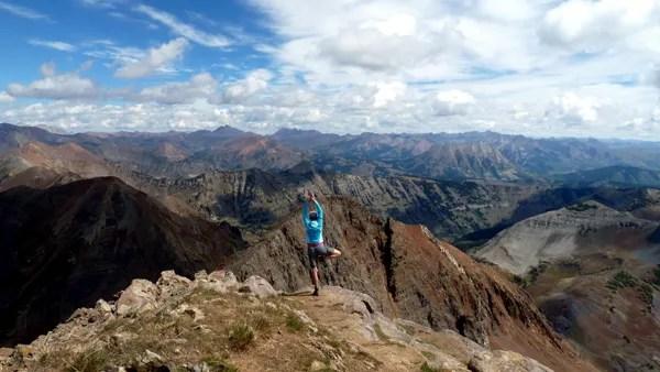 A friend on the summit of Mount Owen