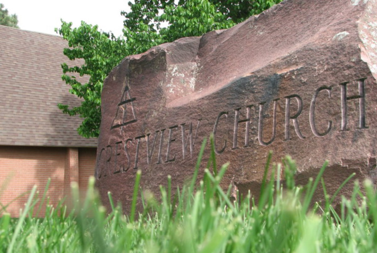 Photo of a large boulder at Crestview Church that has Crestview Church inscribed on it.