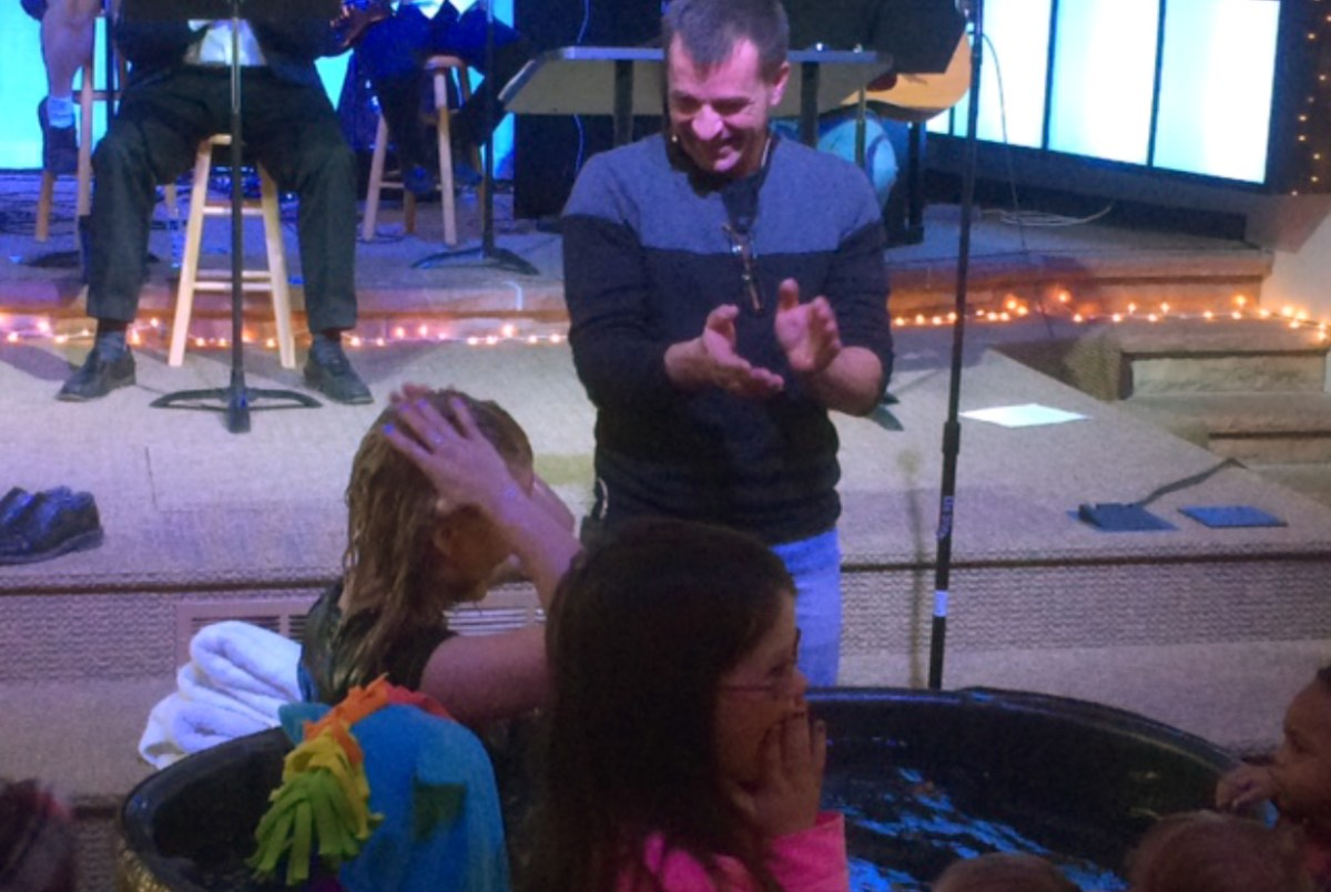Photo of a baptism at Crestview church.
