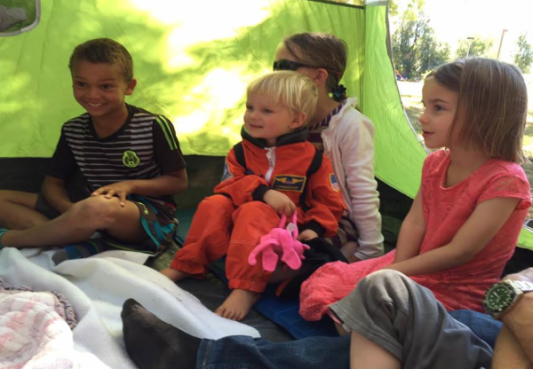 Photo of young kids in tent during camp Crestview.