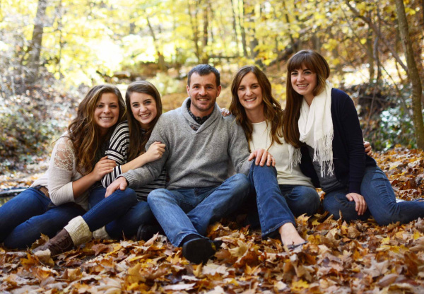 Pastor Mark Quist and his family in Fall leaves.