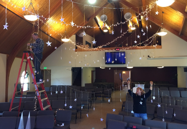 Photo of Christmas decorating in the sanctuary.