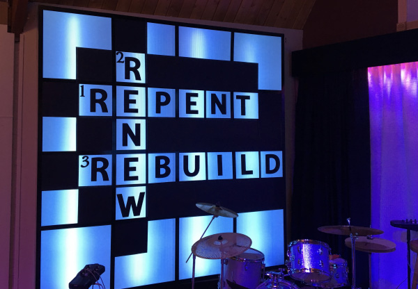 "Photo of sanctuary art of a crossword board with the words, ""Renew, Repent, Rebuild""."