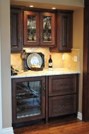 Wine bar with custom appliance fronts