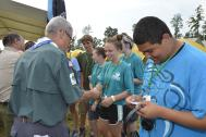 Wayne and Tico hand out their personal Jamboree patches to members of F902.