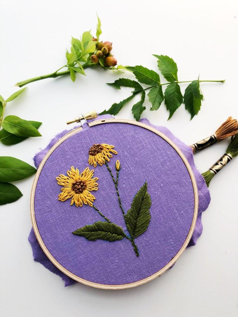 yellow flowers on purple linen embroidery art