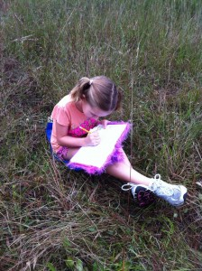 3rd grader journaling at marsh