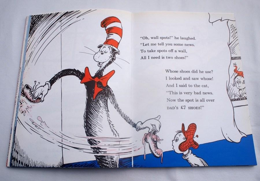 Página donde se ve al gato (the cat in the hat) liandola