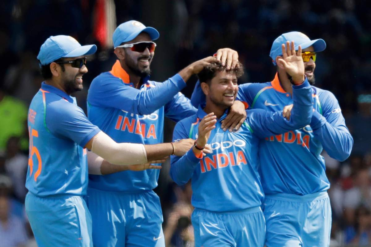 India's Kuldeep Yadav, second right, celebrates taking the wicket of England's Jason Roy with India captain Virat Kohli, right
