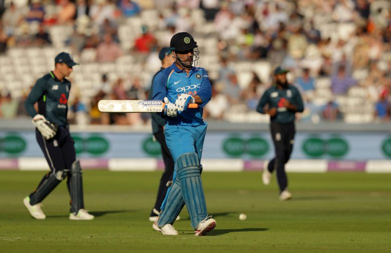 India wicketkeeper M.S. Dhoni walks off the field of play after losing his wicket from the bowling of England's Liam Plunkett