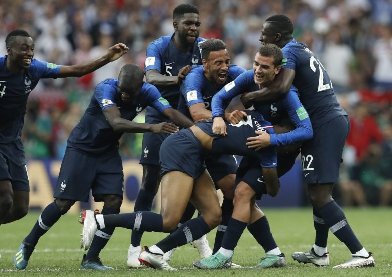 French players celebrate at the end of the final match between France and Croatia at the 2018 soccer World Cup in the Luzhniki Stadium in Moscow