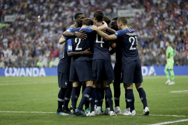 France's players celebrate after teammate Antoine Griezmann scored a penalty kick during the final match between France and Croatia at the 2018 soccer World Cup in the Luzhniki Stadium in Moscow