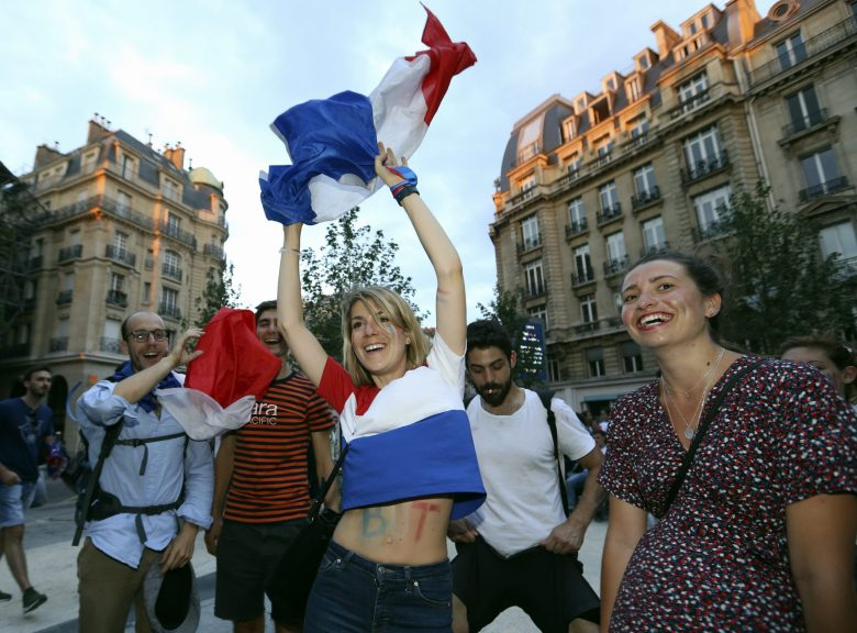 Supporters celebrate after France won the soccer World Cup final between France and Croatia