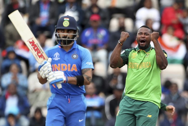 South Africa's Andile Phehlukwayo, right, celebrates the dismissal of India's captain Virat Kohli