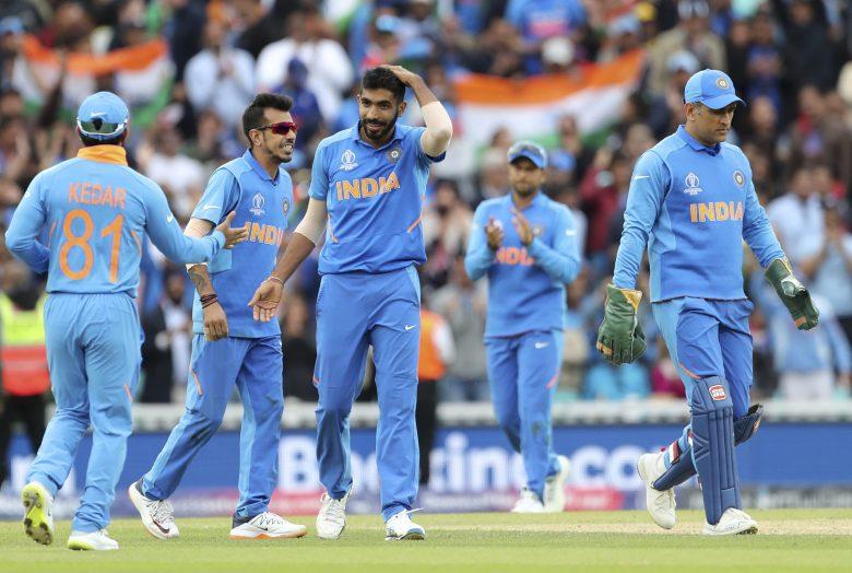 India's Jasprit Bumrah, center, celebrates the dismissal of Australia's Pat Cummins
