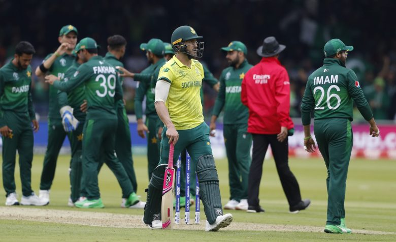 South Africa's captain Faf du Plessis walks off the pitch after being given out caught by Pakistan's captain Sarfaraz Ahmed