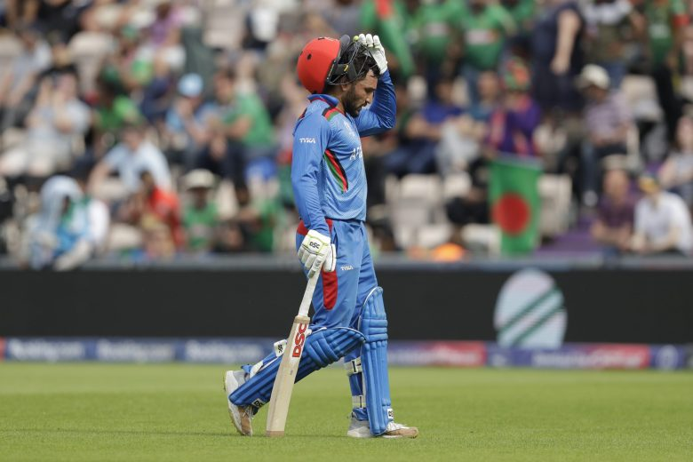 Afghanistan's captain Gulbadin Naib walks off the field of play after losing his wicket from the bowling of Bangladesh's Shakib Al Hasan