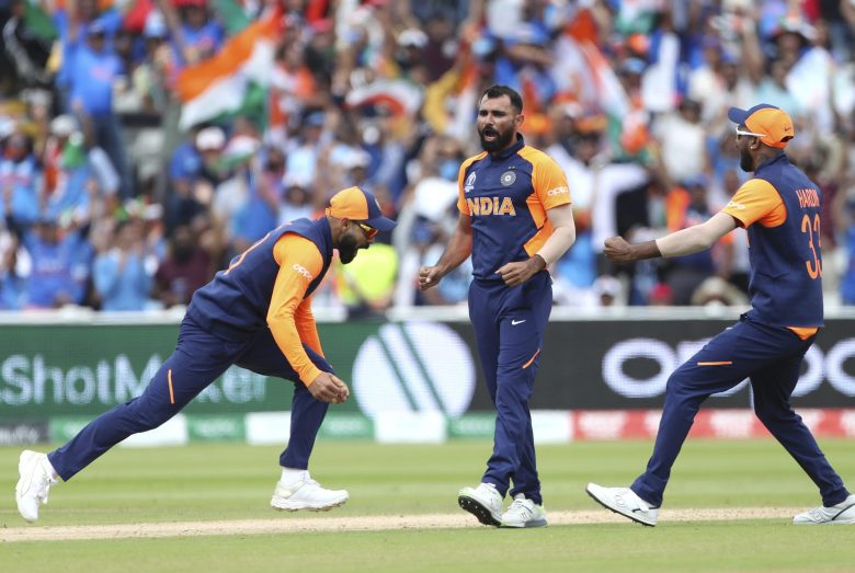 India's Mohammed Shami, center, and teammates celebrate the dismissal of England's captain Eoin Morgan