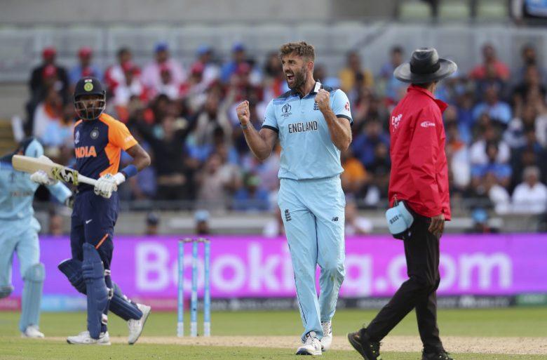 England's Liam Plunkett celebrates after the dismissal of India's Hardik Pandya, left