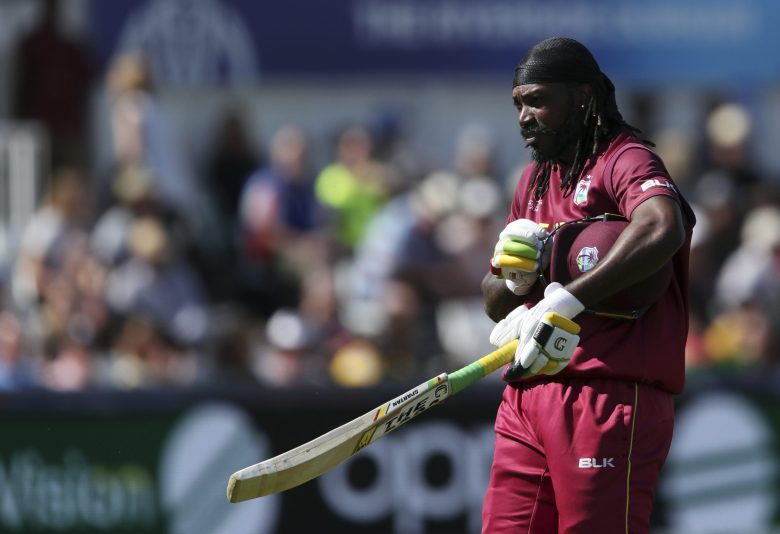 West Indies' batsman Chris Gayle leaves the crease after being dismissed by Sri Lanka's bowler Kasun Rajitha