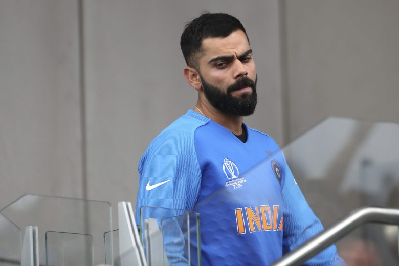 India's captain Virat Kohli reacts after their loss in the Cricket World Cup semi-final match against New Zealand