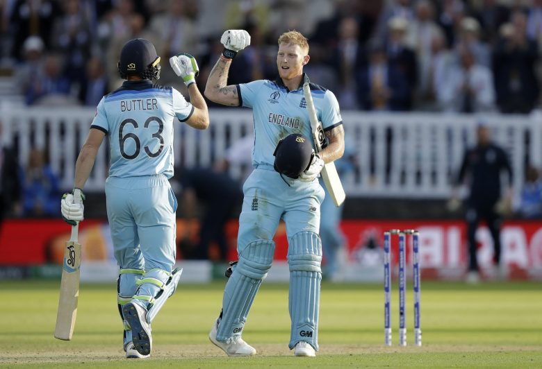 England's Ben Stokes and Jos Buttler react at the end of their super over after the scores finished tied at the end of the Cricket World Cup final match