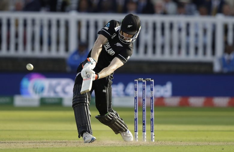 New Zealand's James Neesham hits a 6 in a super over after the scores finished tied at the end of the Cricket World Cup final match