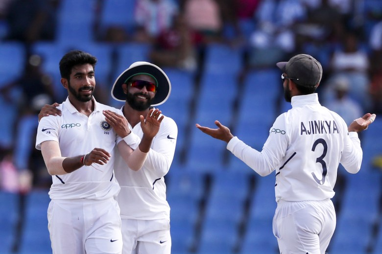 India's Jasprit Bumrah is congratulated by teammates after taking the wicket of West Indies' captain Jason Holder
