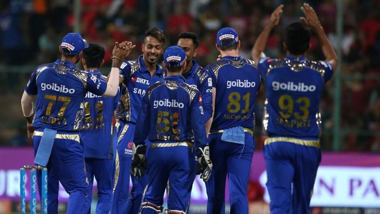 Mumbai Indians' Hardik Pandya, third left, celebrates with teammates the dismissal of Royal Challengers Bangalore's Washington Sundar