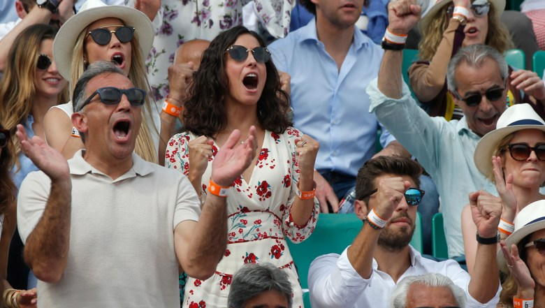 Spain's Rafael Nadal's girlfriend Xisca Perello, center left, screams as he scores a point against Austria's Dominic Thiem in the men's final match of the French Open tennis tournament at the Roland Garros stadium in Paris