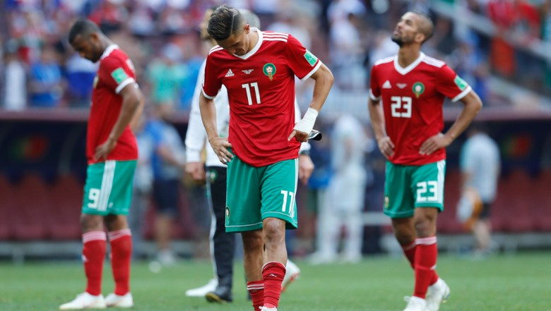 Morocco's Faycal Fajr and Morocco's Mehdi Carcela leave the pitch after losing the group B match between Portugal and Morocco at the 2018 soccer World Cup in the Luzhniki Stadium in Moscow