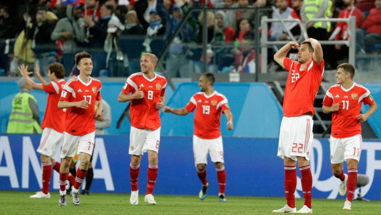 Russia's Artyom Dzyuba, 2nd right, celebrates after scoring his side's 3rd goal during the group A match between Russia and Egypt at the 2018 soccer World Cup in the St. Petersburg stadium in St. Petersburg
