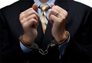 executive in handcuffs