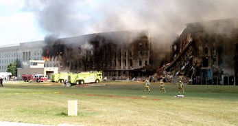 Firefighters_struggle_to_contain_the_fire,_after_the_September_11,_2001,_terrorist_attack_on_the_Pentagon_010911-F-XT317-003