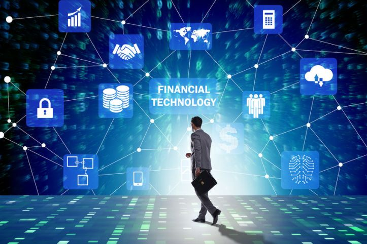 89146729 - businesswoman walking towards financial technology fintech