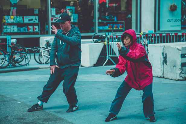 photo a man and woman doing martial arts