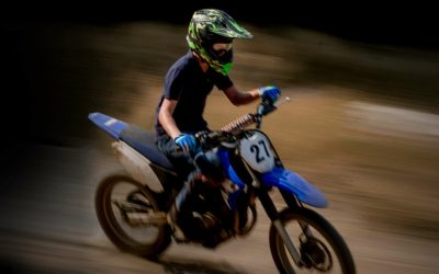 Youth riding dirt bike