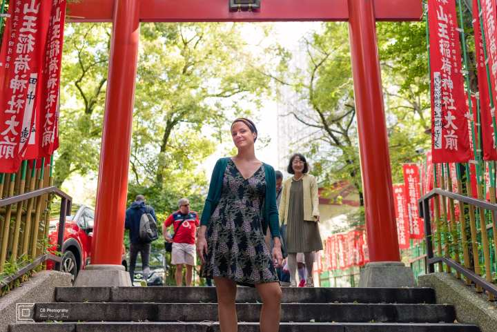 Vacation photograph of Camilla, at the top of the red torii gates at Hie Shrine in downtown, portrait by Cristian Bucur Photographer in Tokyo Metropolitan Area