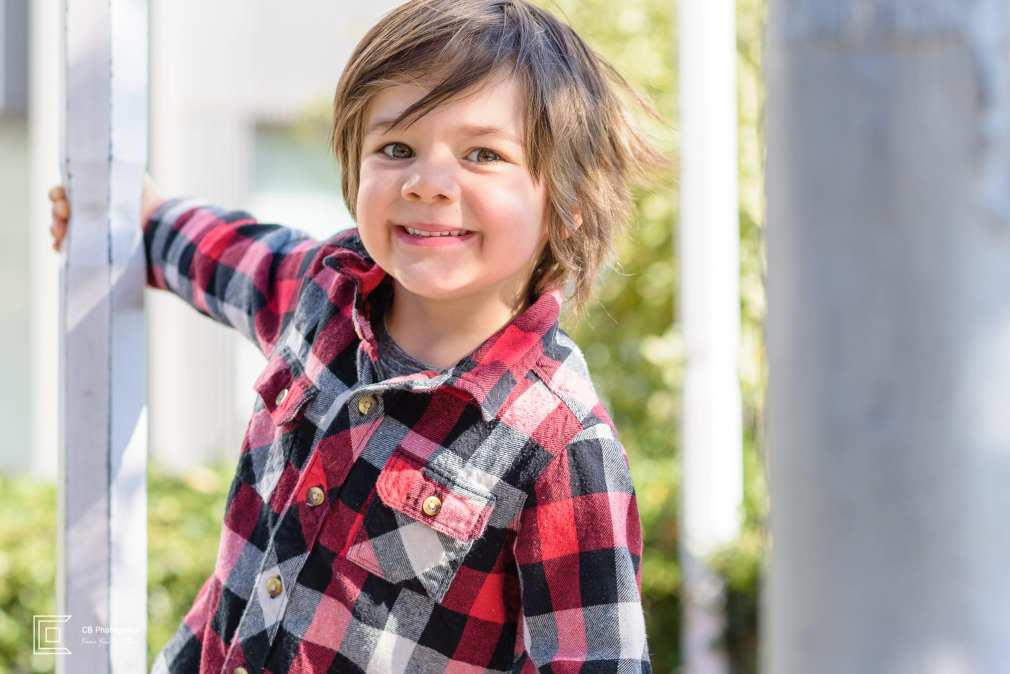 Portrait of a boy playing and smiling in Roppongi Hills during a family shoot by the Tokyo family photographer Cristian Bucur