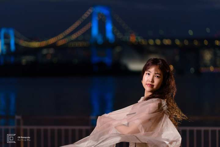 Night portrait shoot in Odaiba-Tokyo, with Rainbow Bridge lit in the background