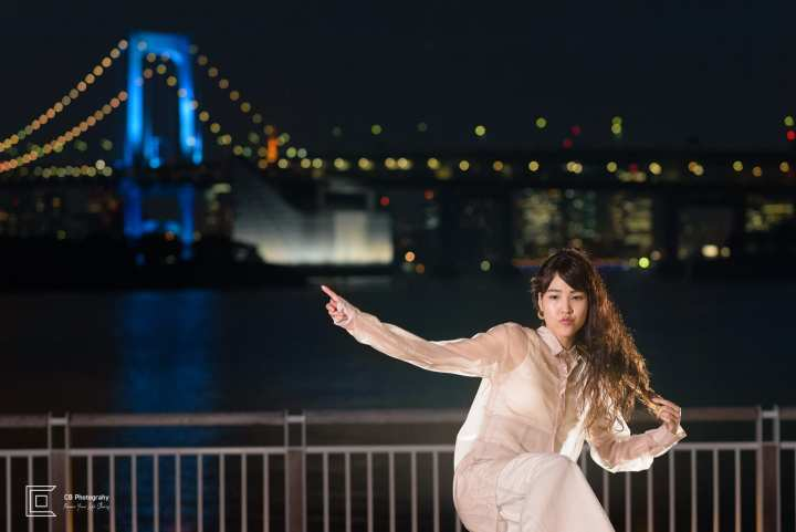 Night portrait in Odaiba-Tokyo, with Rainbow Bridge lit in the background