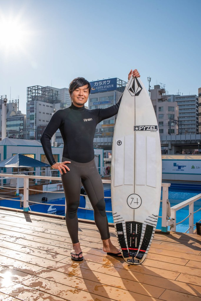 River Surfer proudly holding his surfboard at Citywave Tokyo
