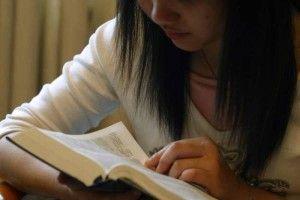 woman reading Bible 300x200