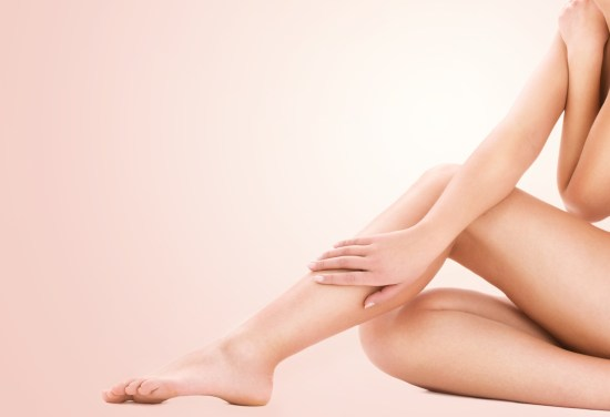 picture of healthy naked woman legs over beige background